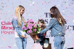 Paris-Hilton-&-Victoria-Justice-present-Miracle-Kid-Sasha-with-flowers-courtesy-of-The-Bouqs---Toni-Love
